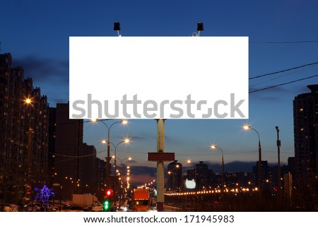 Empty roadside billboards at evening in city - stock photo
