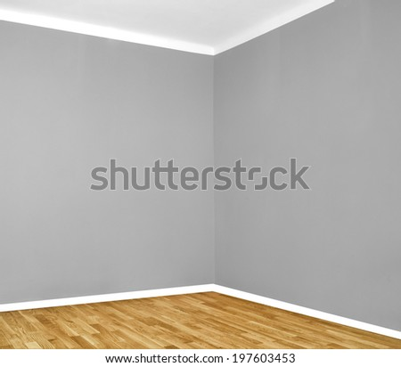 empty room corner with wooden floor and grey wall  - stock photo