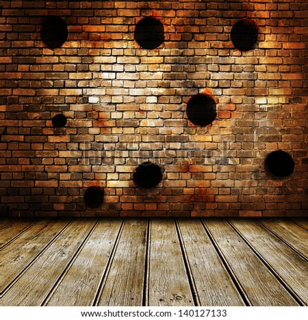 Empty room interior with brickwall and wooden floor. Bullet holes on wall - stock photo