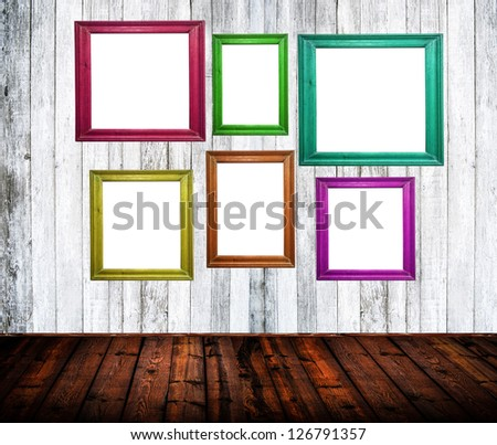 Empty room interior with colorful picture frames - stock photo