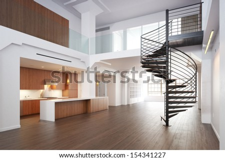 Empty room of residence with a spiral staircase. - stock photo