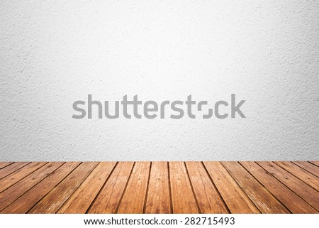Empty room of white cement plaster wall and wood floor - stock photo