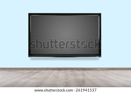 Empty room with HD TV at the wall. - stock photo
