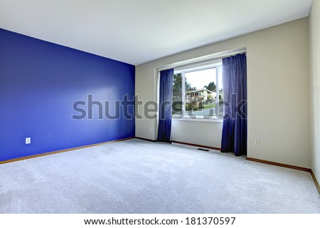 Empty room with lavender carpet floor. royal wall and purple curtains - stock photo