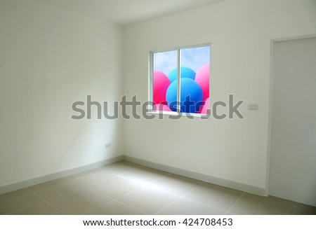 Empty room with opened window colorful balloon outside. - stock photo
