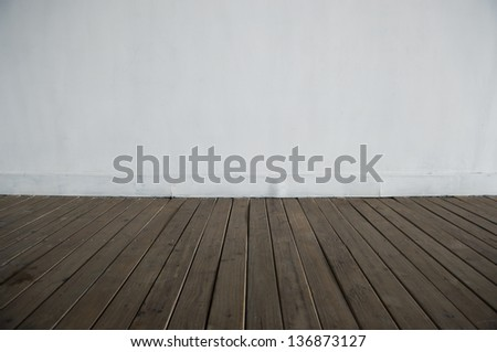 empty room  with white wall and wood floor background. - stock photo