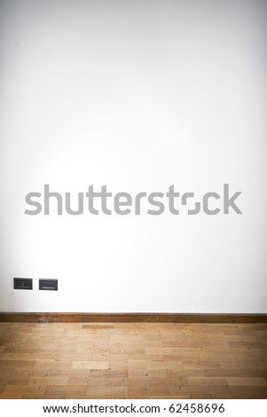 empty room with white wall and wooden flor vertical composition - stock photo