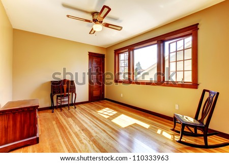Empty room with yellow walls and hardwood floor in the nice old house. - stock photo