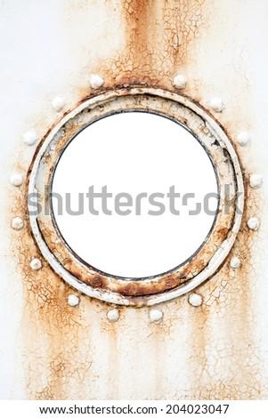 Empty round rusted porthole on white ship wall - stock photo