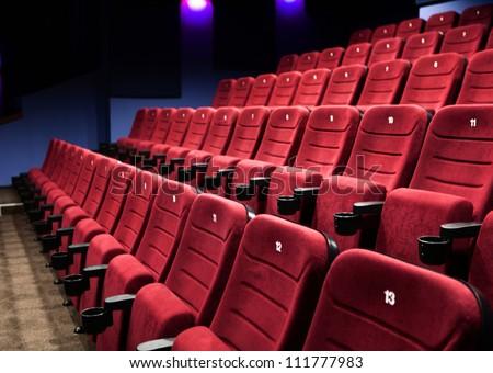 Empty rows of  red cinema seats - stock photo