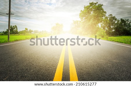 empty rural road background with lighting effect - stock photo