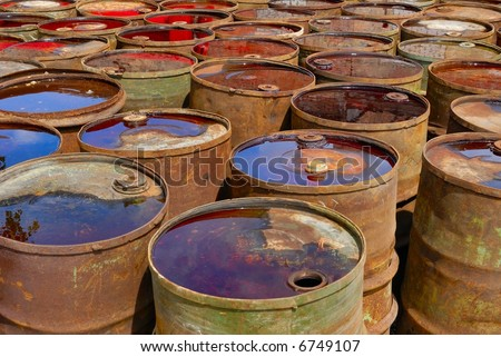 empty rusting chemical barrels - stock photo
