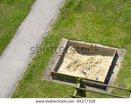 Empty sand box with toys - stock photo