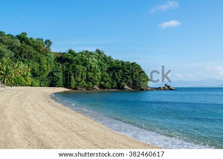 Empty sandy beach in the middle of the ocean - stock photo