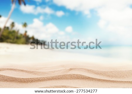 Empty sandy beach with sea. Free space for text or product placement - stock photo