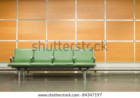 empty seats at a business building against a wooden wall (gorgeous interior setting) - stock photo