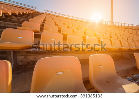 Empty seats at soccer stadium - stock photo