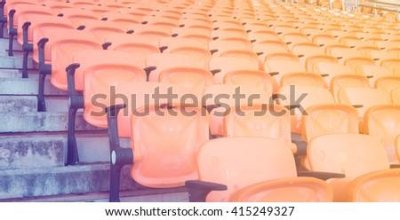 Empty seats at soccer stadium , vintage tone - stock photo