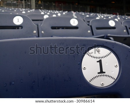 Empty seats during a rain delay in Washington Nationals baseball stadium. - stock photo