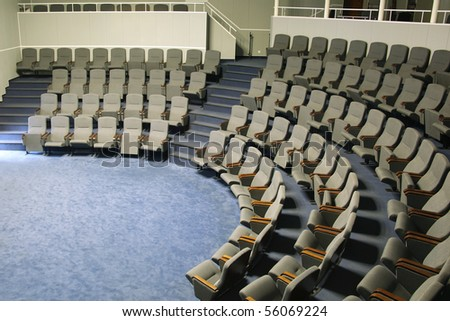 Empty seats in a big hall - stock photo