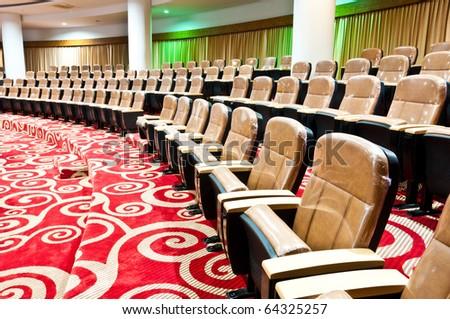 empty seats in auditorium interior - stock photo