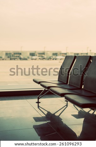 Empty seats in terminal waiting room in airport. - stock photo