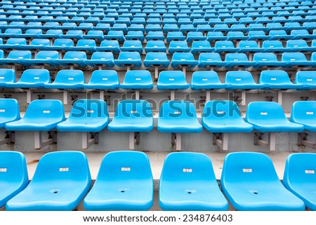 Empty seats of stadium's stand - stock photo