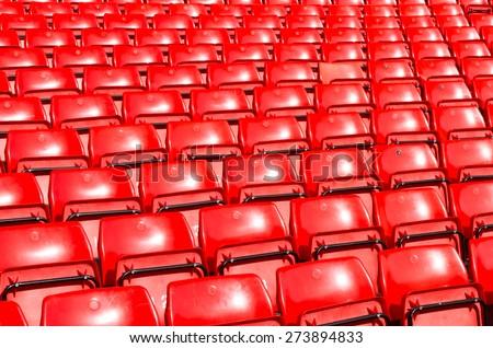 Empty seats red at outdoor stadium. - stock photo