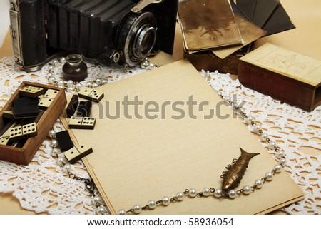 Empty sheet, retro camera, antique domino - stock photo