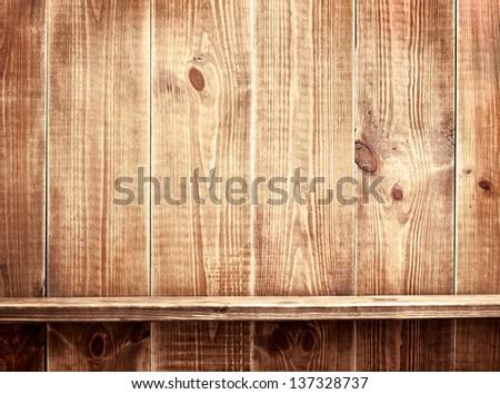 Empty shelf on wooden background. Wood texture. - stock photo