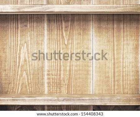 Empty shelf on wooden wall - stock photo
