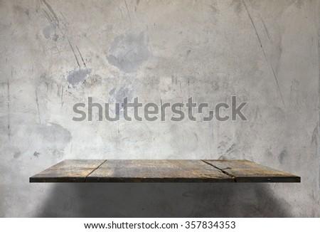 empty shelves on concrete wall - stock photo