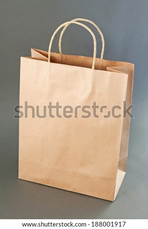 Empty Shopping Bag from craft paper, Recycled paper shopping bag on gray background - stock photo