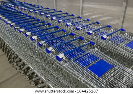 Empty shopping carts in the parking lot, no buyers. Concept of bad time of crisis. Perspective view - stock photo