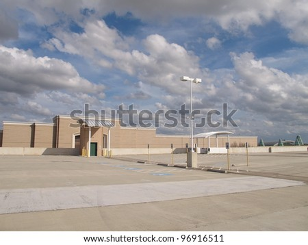 Empty shopping mall rooftop parking lot, Sugar Land, Texas, USA - stock photo