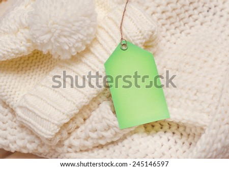 Empty shopping tag card template knitting background. - stock photo