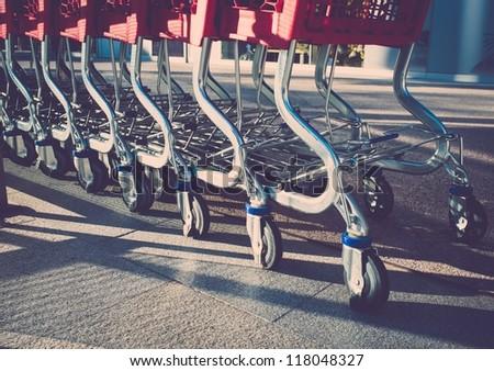 Empty shopping trolleys - stock photo