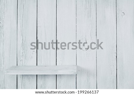Empty short shelf from a tree. A wooden background. - stock photo