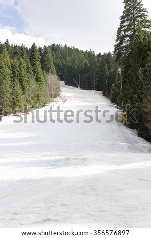 Empty ski path at cold winter day. Rila Mountain, Bulgaria. - stock photo