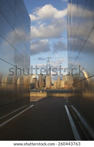 Empty Sky: Jersey City 9/11 Memorial at sunset shows One World Trade Center (1WTC), Freedom Tower, New Jersey, USA, 03.20.2014 - stock photo