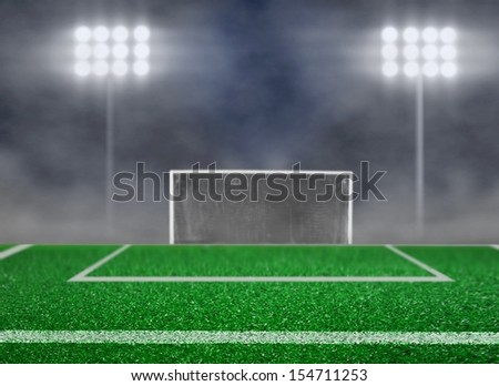 Empty Soccer Field and Spotlight with Smoke - stock photo