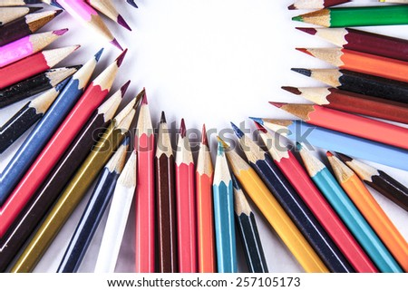 Empty space background of bunch of colored pencils on paper Idea of concentration and attraction to nucleus center circle radius unity concept of leadership, community, the team focused on one goal - stock photo