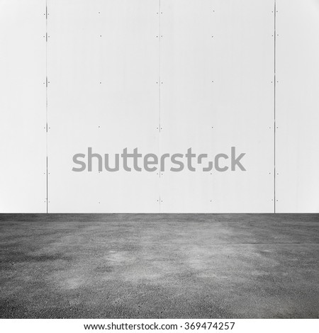 Empty square abstract interior background with white metal wall and asphalt pavement - stock photo