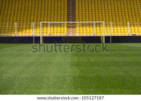 Empty stadium and the goal - stock photo
