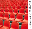 Empty stadium seats at open air sports arena. - stock photo