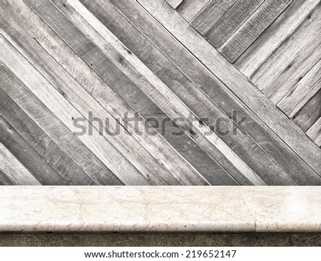 Empty stone marble table and blurred pale plank wooden wall in background,Template for display your product - stock photo