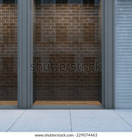 Empty storefront with brick wall - stock photo