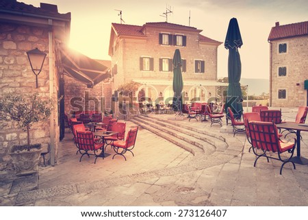 empty street cafe on the square of a European city - stock photo