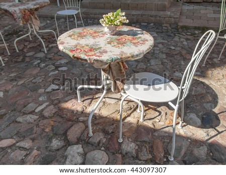 Empty street cafe, table and chair - stock photo