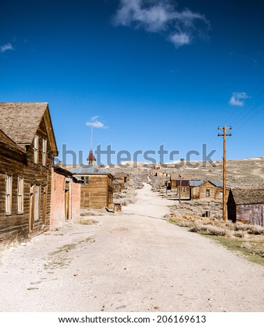 Empty street in the ghost town Bodie - stock photo